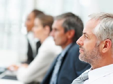Börsenmanager während einer Konferenz © Yuri Arcurs, Fotolia